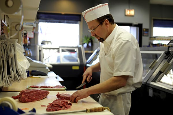 Butcher-Preparing-Meat