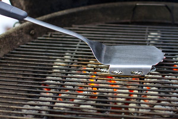 Grill-Brush-on-a-Charcoal-Grill